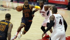 May 20, 2015; Atlanta, GA, USA; Cleveland Cavaliers forward LeBron James (23) drives against Atlanta Hawks forward DeMarre Carroll (5) during the third quarter of game one of the Eastern Conference Finals of the NBA Playoffs at Philips Arena. Mandatory Credit: Brett Davis-USA TODAY Sports