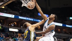 Mar 30, 2015; Minneapolis, MN, USA; Minnesota Timberwolves guard Andrew Wiggins (22) dunks in the second quarter against the Utah Jazz center Rudy Gobert (27) at Target Center. Mandatory Credit: Brad Rempel-USA TODAY Sports