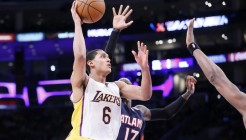 15 March 2015: Los Angeles Lakers guard Jordan Clarkson (6) goes for the layup past Atlanta Hawks guard Dennis Schroder (17) during the Atlanta Hawks 91-86 victory over the Los Angeles Lakers, at the Staples Center, Los Angeles, California, USA.