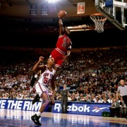 NEW YORK - 1993:  Michael Jordan #23 of the Chicago Bulls jumps to the basket for a slam dunk against the New York Knicks during an NBA game circa 1993 at Madison Square in New York, New York. NOTE TO USER: User expressly acknowledges and agrees that, by downloading and or using this Photograph, user is consenting to the terms and conditions of the Getty Images License Agreement.  Mandatory Copyright Notice: Copyright 1993 NBAE (Photo by Lou Capozzola/NBAE via Getty Images)