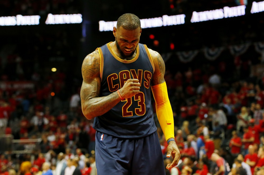ATLANTA, GA - MAY 20:  LeBron James #23 of the Cleveland Cavaliers reacts in the final minutes of their 97 to 89 win over the Atlanta Hawks during Game One of the Eastern Conference Finals of the 2015 NBA Playoffs at Philips Arena on May 20, 2015 in Atlanta, Georgia. NOTE TO USER: User expressly acknowledges and agrees that, by downloading and or using this Photograph, user is consenting to the terms and conditions of the Getty Images License Agreement.  (Photo by Kevin C. Cox/Getty Images) ORG XMIT: 554941735 ORIG FILE ID: 474159826