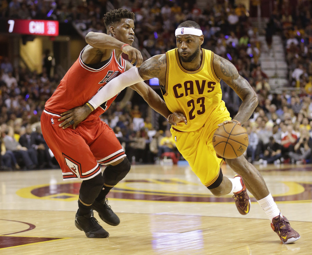 Cleveland Cavaliers forward LeBron James (23) drives against Chicago Bulls guard Jimmy Butler (21) during the first half of Game 2 in a second-round NBA basketball playoff series Wednesday, May 6, 2015, in Cleveland. (AP Photo/Tony Dejak) ORG XMIT: OHJJ119