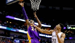 Nov 12, 2014; New Orleans, LA, USA; Los Angeles Lakers guard Kobe Bryant (24) shoots over New Orleans Pelicans forward Anthony Davis (23) during  a game at the Smoothie King Center. The Pelicans defeated the Lakers 109-102. Mandatory Credit: Derick E. Hingle-USA TODAY Sports