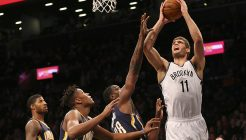 Mar 26, 2016; Brooklyn, NY, USA;  Brooklyn Nets center Brook Lopez (11) reaches for the net during the third quarter against the Indiana Pacers at Barclays Center. Brooklyn Nets won 120-110. Mandatory Credit: Anthony Gruppuso-USA TODAY Sports