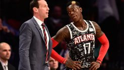 Feb 13, 2015; New York, NY, USA; World Team head coach Kenny Atkinson of the Atlanta Hawks (left) instructs World Team guard Dennis Schroder of the Atlanta Hawks (17) during the second half against the U.S. Team at Barclays Center. Mandatory Credit: Bob Donnan-USA TODAY Sports