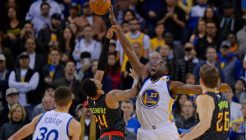 Golden State Warriors' Draymond Green (23) blocks a shot by Atlanta Hawks' Kent Bazemore (24) during the fourth quarter of their NBA game at the Oracle Arena in Oakland, Calif. on Monday, Nov. 28, 2016. The Warriors defeated the Hawks 105-100. (Jose Carlos Fajardo/Bay Area News Group)